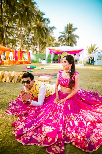 Bride and groom posing together during the mehndi fuction