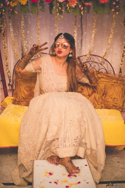 sunglass bride giving a quirky pose