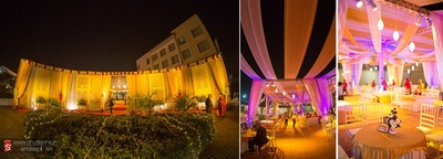 Wedding venue decorated with drapes, clustered floral arrangement, lightings, table center pieces and fairy lights
