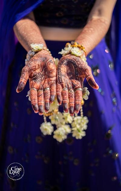 The bride showing off her pretty mehendi designs.