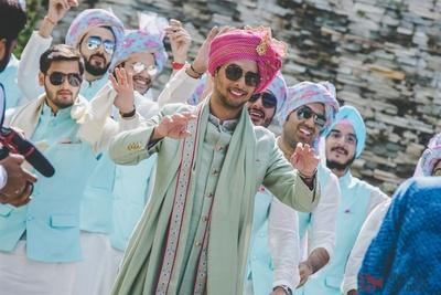 The groom and his baraat dancing their way into  the wedding venue