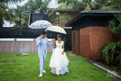 Bride and groom enter their monsoon reception for the ring exchange