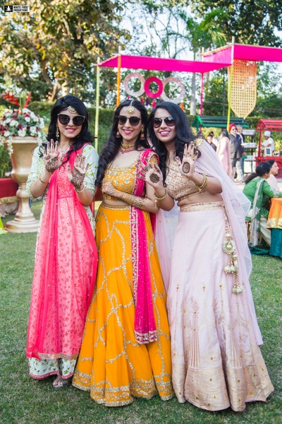 The bride and bridesmaids are having some fun time at the mehendi!