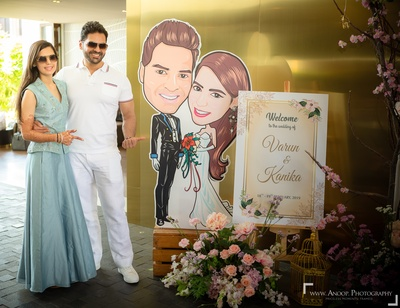 The couple posing near their life-size caricature!