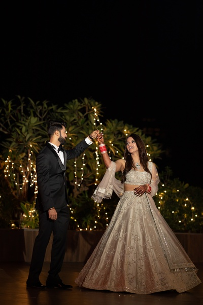 a candid capture of the groom twirling the bride at the reception