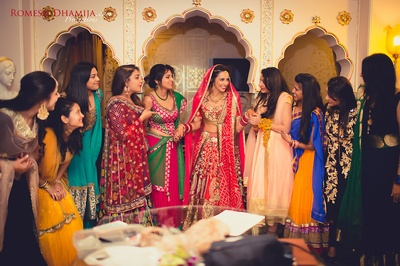 Bride with her bridesmaids, all dressed up in colorful outfits for the Ceremony.
