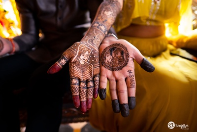 quirky mehendi designs on bride and groom's hands