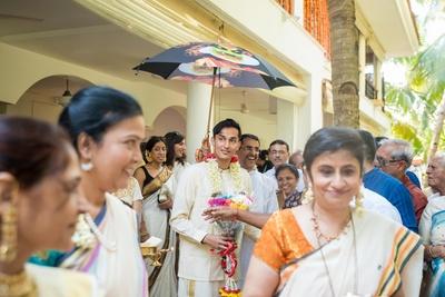 Traditional groom enter the wedding mandap