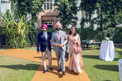 Tegh dressed up in a grey three piece paired with pastel pink tie, pocket square and turban for the jewish wedding.