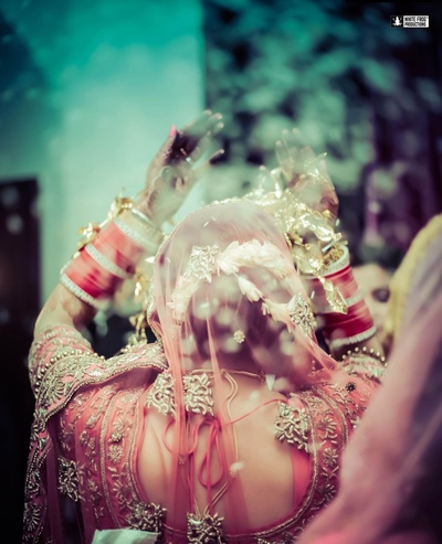 Beautiful shot by ace wedding photographers White Frog Production of the bride exiting.