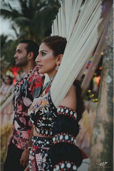 the bride and groom in dramatic ensemble for the henna sundowner
