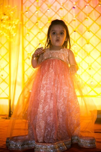 Peach netted floorlength dress with silver border for girls