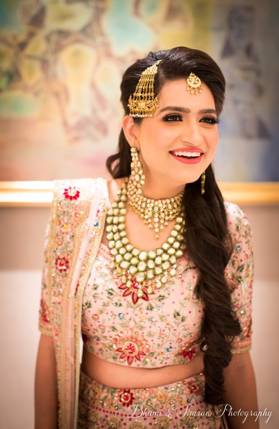The bride looks like a million bucks in this cream lehenga with heavy embroidery and polki jewellery.