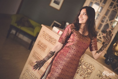 The bride poses at her mehendi ceremony!