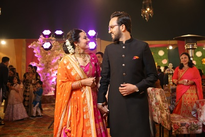 Candid capture of the couple at their sangeet ceremony