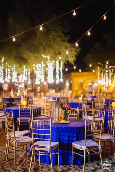 Notr to miss the simplistic chairs, blue table overlays and vintage moroccan centerpieces.