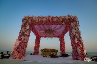 A stunning wedding floral mandap with different hues of pink!