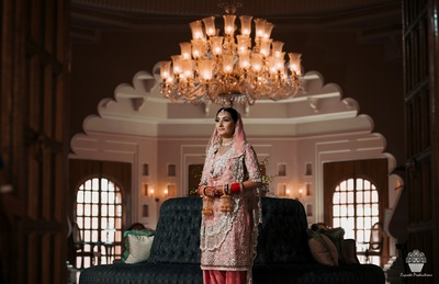 Bride captured in a Manish Malhotra suit for the wedding ceremony