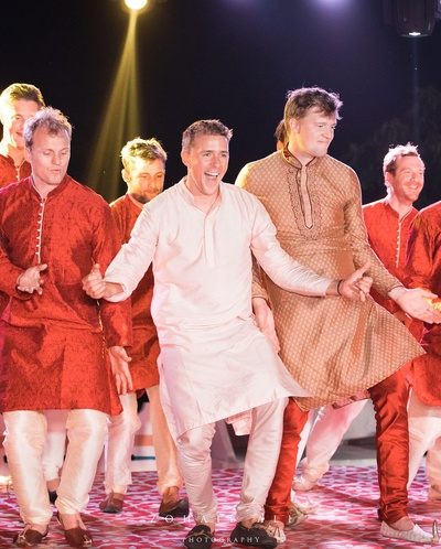 groom with his groomsmen dancing for the sangeet ceremony
