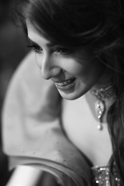 a beautiful black and white portrait of the bride at the cocktail party