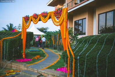 Floral entrance decor for mehendi ceremony.