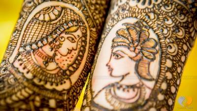 Imprints of the bridegroom on bridal mehendi