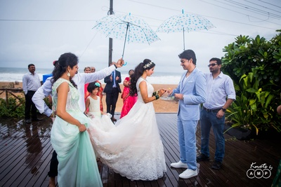 Ring exchange between bride and groom during the beach reception