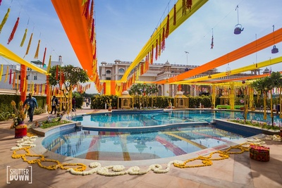Yellow haldi decor by the pool side