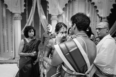 The groom trying to console the bride who turns emotional after the wedding.