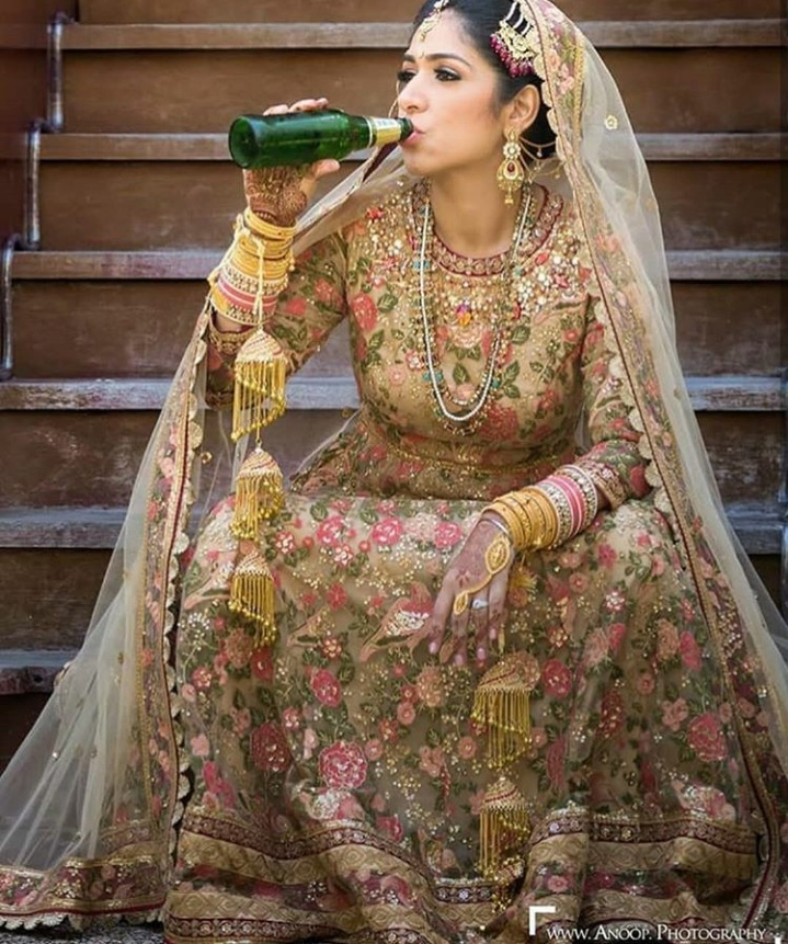 3. We love how this bride is sipping on some beer before her big moment