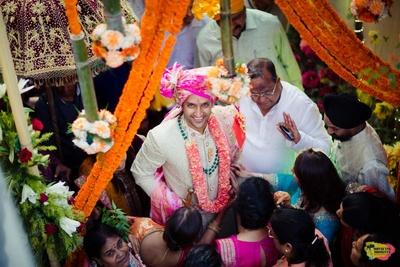 Top shot of the groom entering the wedding venue
