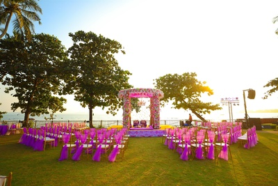 A beautiful floral mandap, with matching fuschia pink chair decor- against a breathtaking view!