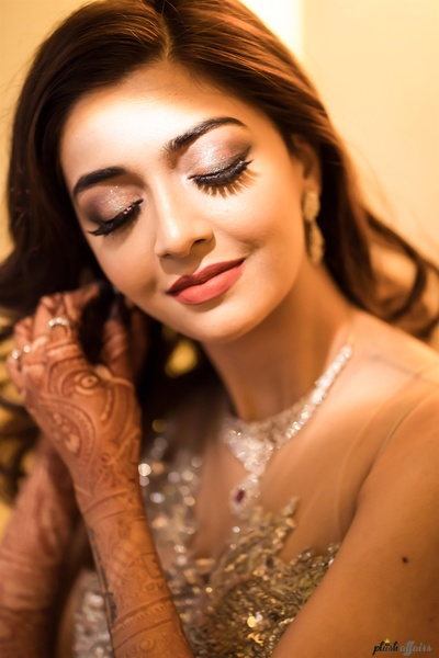 the bride opted for subtle makeup with smokey eyes and long eyelashes for her engagement