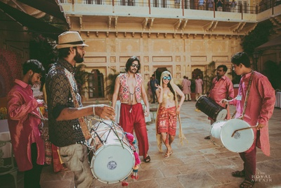Bride and groom enter the venue for their haldi ceremony dancing to the beats of dhol.