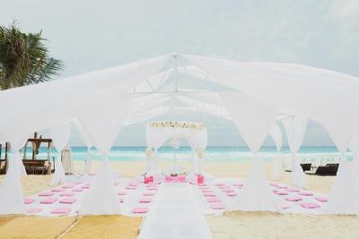 Mandap decor on the beach for the white themed  destination wedding