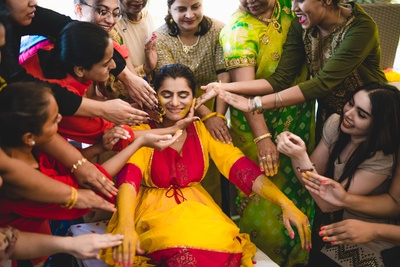 The bride is all smiles during her haldi ceremony!