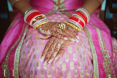 Hands filled with beautiful mehendi designs.