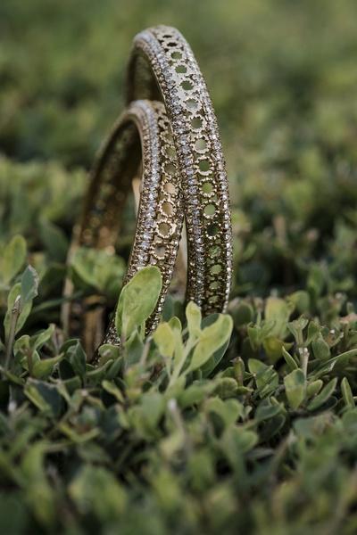 A close-up shot of the bride's diamond bangles.
