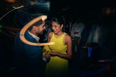 Bride and groom dancing together at their sangeet ceremony