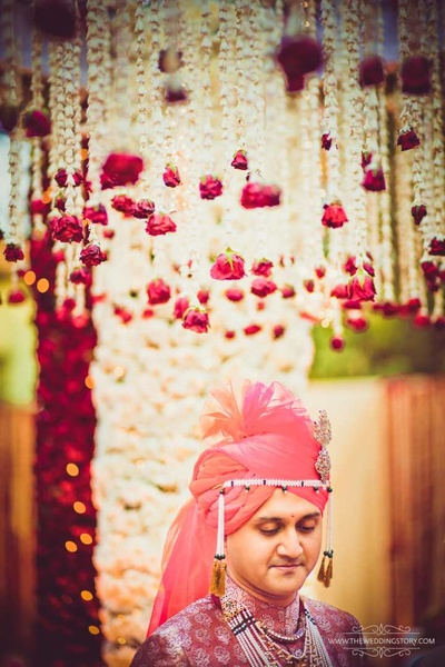 Wedding photography of the groom at the floral mandap