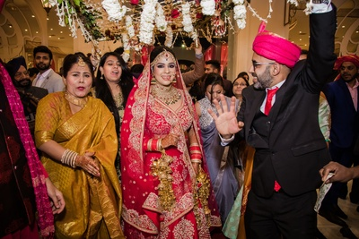 Sukanya is a vision in red as she makes her way under the phoolon ki chaadar.
