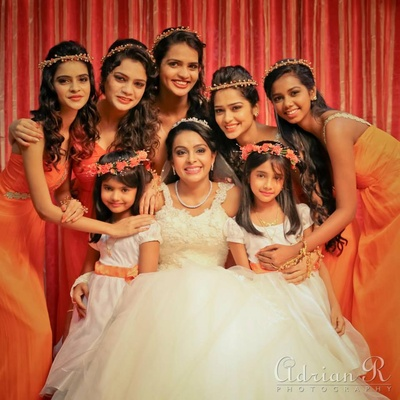 Tangerine bridesmaids dresses styled with head gears