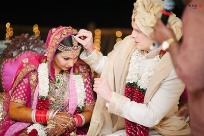 A candid picture of the couple during the sindur ceremony