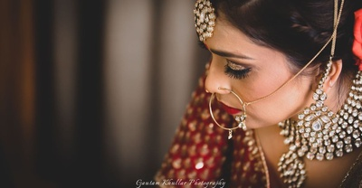 Adorned in heavy and bold kundal neck piece for the wedding day.