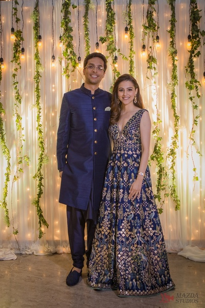 The bride twirling in a ink blue gown with pichwai work and the groom in coordinated ink blue sherwani  by Anita Dongre at their Cocktail held in Mumbai