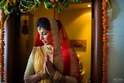 Elegant simple wedding lehenga styled with red sheer dupatta and kundan-gold jewellery