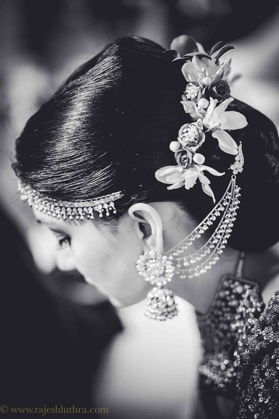 Bridal updo adorned with polki studded head jewellery and fresh flowers