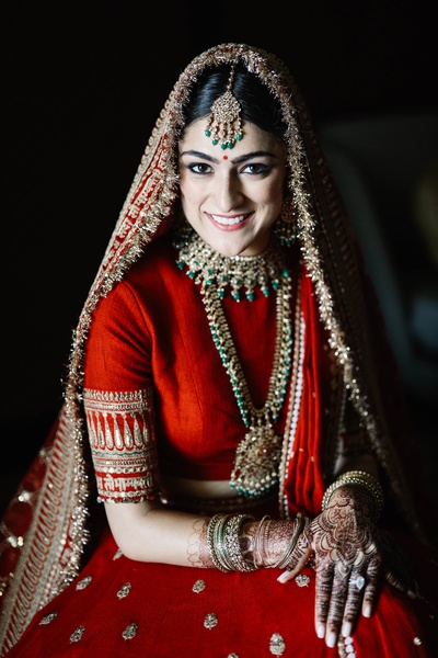 The bride is looking like a billion bucks in this Sabysachi lehenga.