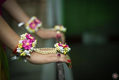 Varshika adorning pretty floral jewellery at her mehendi ceremony.