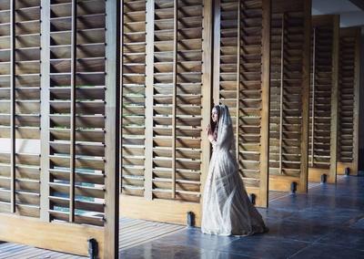 Komal poses in her bridal lehenga for Moni Adri Photography